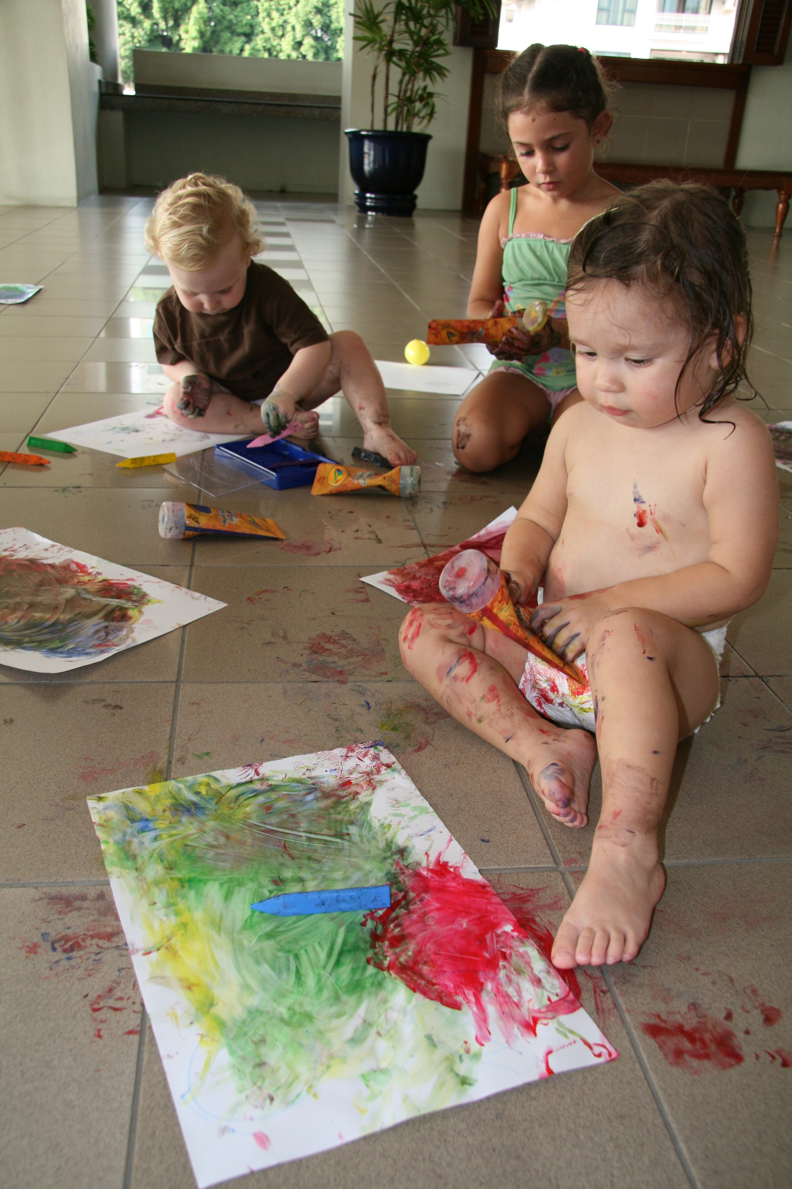 use those hands to finger paint toddle joy