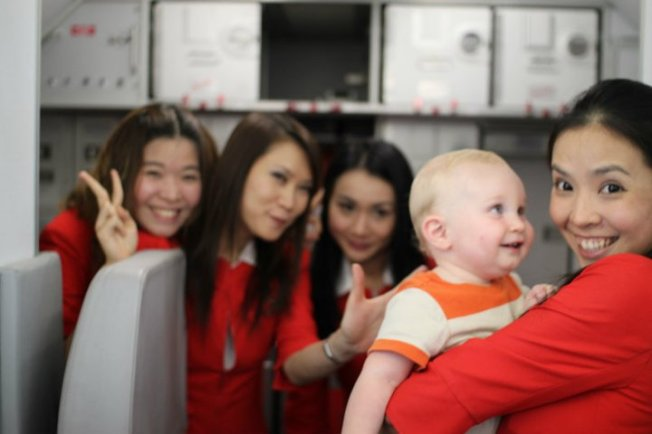 Air Travel Done Right:  Logan on a Flight to Bali at 10 Months Old